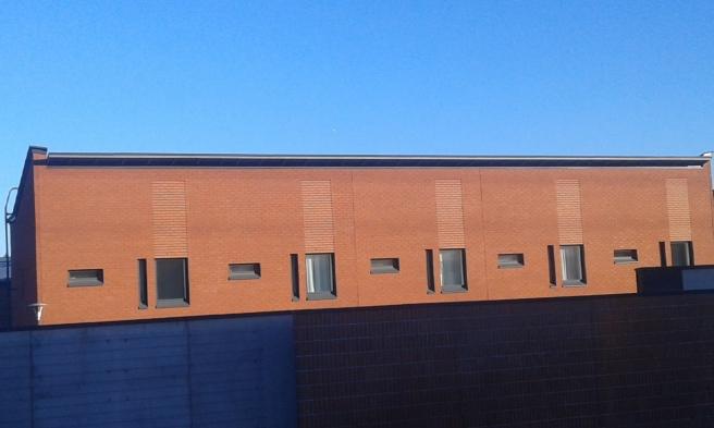 4. Fasad bakom bullervall i Mellungsbacka.