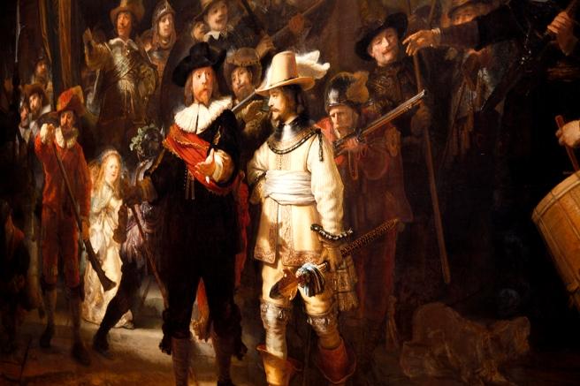 En detaljstudie av Rembrandts mästerverk Nattvakten.